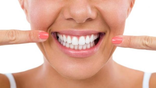 smile 600x339 - 4 tips to help you enjoy Easter treats and still look after your teeth